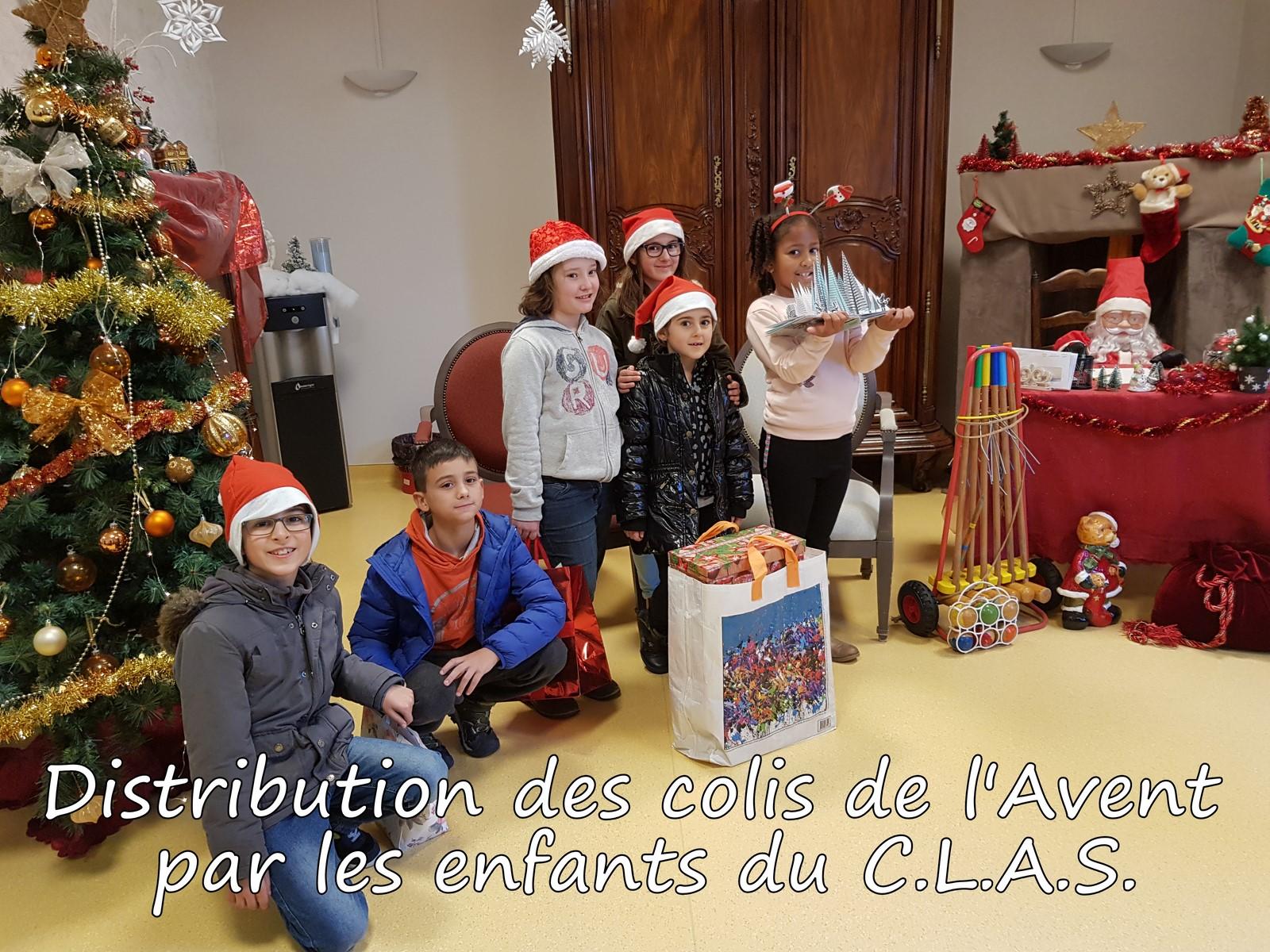 Distribution-des-Colis-de-lAvent-par-les-enfants-du-CLAS